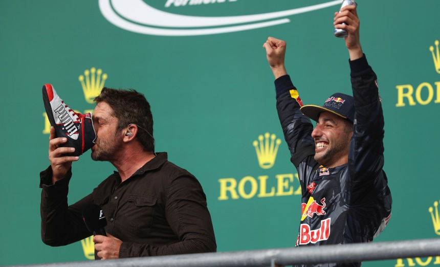 AUSTIN, TX - OCTOBER 23:  Actor Gerard Butler does a shoey on the podium with Daniel Ricciardo of Australia and Red Bull Racing after Daniel finished third in the race during the United States Formula One Grand Prix at Circuit of The Americas on October 23, 2016 in Austin, United States.  (Photo by Clive Mason/Getty Images) // Getty Images / Red Bull Content Pool  // P-20161023-01072 // Usage for editorial use only // Please go to www.redbullcontentpool.com for further information. //